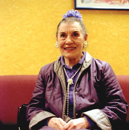A purple-clad bingo-playing old lady