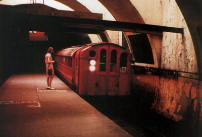 A woman standing on the platform of West St. station on the old Glasgow Underground